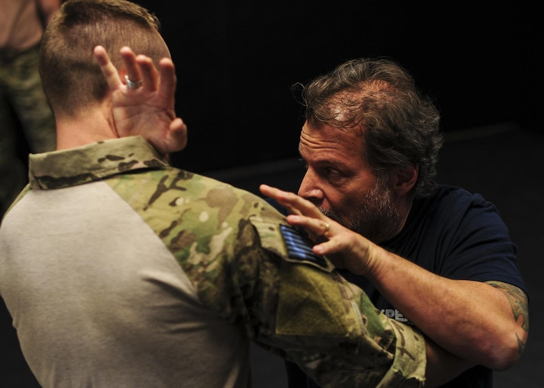 Tony Blauer, founder of Blauer Tactical Systems Inc., instructs Survival, Evasion, Resistance and Escape specialists during a week-long Spontaneous Protection Enabling Accelerated Response System course at Davis-Monthan Air Force Base, Ariz., April 27, 2017. Self-defense is a major component of support provided by SERE specialists to troops who have a high risk of isolation in theater, such as downed-pilots and operators. (U.S. Air Force photo by Senior Airman Chris Drzazgowski)