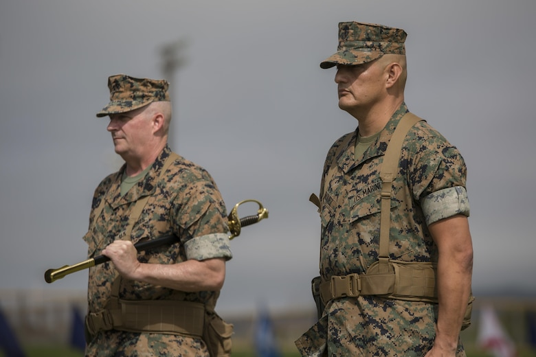 Sgt. Maj. Mario A. Marquez stands ready to receive the noncommissioned officer sword, symbolizing his appointment as III Marine Expeditionary Force sergeant major, during a ceremony at Camp Hansen, Okinawa, Japan, May 12, 2017. Sgt. Maj. Lee D. Bonar Jr. relinquished his post to Marquez and retired after enlisting out of Wheeling, West Virginia, 32 years ago. Marquez is a native of Lakewood, California.