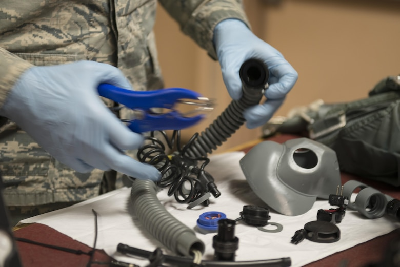 EIELSON AIR FORCE BASE, Alaska – U.S. Air Force Senior Airman Garrett Bryden, a 4th Operations Support Squadron aircrew flight equipment technician assigned to Seymour Johnson Air Force Base, N.C., puts together an oxygen mask May 4, 2017, during NORTHERN EDGE 2017 (NE17), at Eielson Air Force Base, Alaska. NE17 is Alaska's premier joint training exercise designed to practice operations, techniques and procedures as well as enhance interoperability among the services. Thousands of participants from all the services, Airmen, Soldiers, Sailors, Marines and Coast Guardsmen from active duty, Reserve and National Guard units are involved. (U.S. Air Force photo/Staff Sgt. Ashley Nicole Taylor)