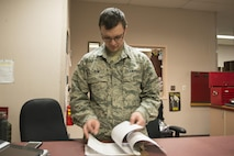 EIELSON AIR FORCE BASE, Alaska – U.S. Air Force Airman 1st Class Johnathan Pein, a 335th Aircraft Maintenance Unit aircrew flight equipment technician assigned to Seymour Johnson Air Force Base, N.C., checks a daily flying log during NORTHERN EDGE 2017 (NE17), at Eielson Air Force Base, Alaska. NE17 is Alaska's premier joint training exercise designed to practice operations, techniques and procedures as well as enhance interoperability among the services. Thousands of participants from all the services, Airmen, Soldiers, Sailors, Marines and Coast Guardsmen from active duty, Reserve and National Guard units are involved. (U.S. Air Force photo/Staff Sgt. Ashley Nicole Taylor)