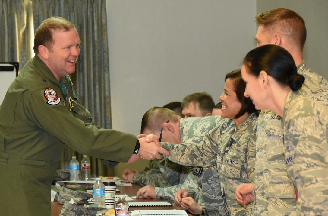 Tenth Air Force Commander Maj. Gen. Richard Scobee greets chaplain corps members from the 920th Rescue Wing, Patrick AFB, Fla., at Naval Air Station Fort Worth Joint Reserve Base, Texas, April 25, 2017. 10th AF chaplains and their assistants gathered here for the first training event specifically for them since the re-designation of the numbered Air Force in 1976. (U.S. Air Force photo by Tech. Sgt. Jeremy Roman)
