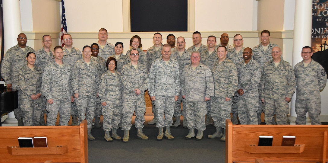 Tenth Air Force Chaplain Corps members pose for a photo in the chapel at Naval Air Station Fort Worth Joint Reserve Base, Texas, April 26, 2017. Chaplains and their assistants gathered here for the first training event specifically for them since the re-designation of the numbered Air Force in 1976. (U.S. Air Force photo by Tech. Sgt. Jeremy Roman)