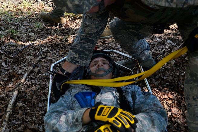 Staff Sgt. Shane Sexton, 185th Civil Engineer Squadron firefighter, lies in a gurney as he plays the role of a casualty during a Silver Flag exercise on Ramstein Air Base, Germany, May 10, 2017. Airmen from various Air National Guard units gathered on Ramstein to participate in Silver Flag, which is a contingency readiness exercise held at several Air Force bases around the world. (U.S. Air Force photo by Airman 1st Class Joshua Magbanua)