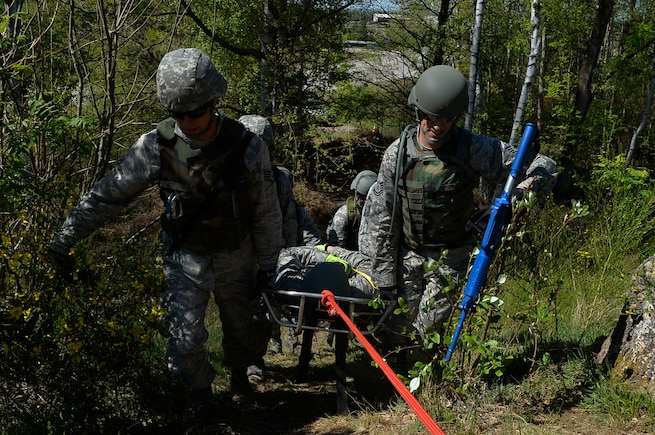 Civil engineer Airmen from various Air National Guard units recover a mock casualty during a Silver Flag exercise on Ramstein Air Base, Germany, May 10, 2017. Silver Flag is a contingency readiness exercise which involves various scenarios to prepare Airmen for being in deployed environments. (U.S. Air Force photo by Airman 1st Class Joshua Magbanua)