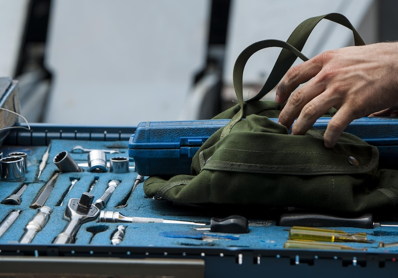 U.S. Air Force Staff Sgt. Dylan Ducharme, 80th Aircraft Maintenance Unit weapons load crew member, reaches for a tool during the 2017 annual weapons load crew competition at Kunsan Air Base, Republic of Korea, May 13, 2017. The annual load competition tests objectives like safety, speed, and cleanliness to enhance PACAF's and ROKAF's mission of always being ready to fight tonight.  (U.S. Air Force photo by Senior Airman Colville McFee/Released)