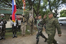 A Philippine and U.S. combined color guard greet Philippine Army Maj. Gen. Angelito De Leon, left, and Col. Laurence Mina during the opening ceremony of Balikatan 2017 at Fort Magsaysay in Santa Rosa, Nueva Ecija, May 8, 2017. De Leon is the commander of 7th Infantry Division and Mina is Deputy Assistant Chief of Staff for Training and Education Staff, Philippine Army. Balikatan is an annual U.S.-Philippine bilateral military exercise focused on a variety of missions including humanitarian and disaster relief, counterterrorism, and other combined military operations.