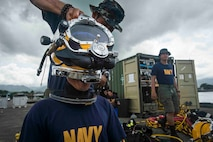 Philippine Sailors prepare for an underwater construction demolition dive in support of Balikatan 2017 at Ipil Port in Ormoc City, Leyte, May 10, 2017. The demolition training prepares the U.S. military and Armed Forces of the Philippines to clear debris in ports and open up supply lines for victims of natural disasters and crises. Underwater demolition can help Philippine and U.S. forces provide humanitarian assistance and disaster relief operations from the sea to remote areas of the Philippines.