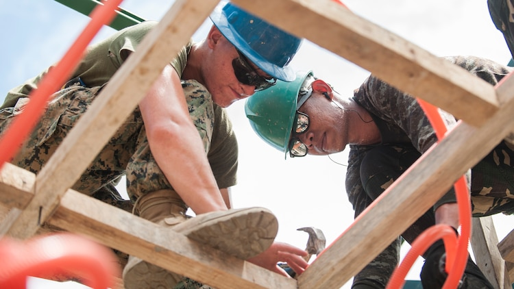 U.S. Marine Lance Cpl. Eli Schmidt, left, and Pvt. Ibarra Dalurio install electrical-wire casing in a new school classroom during Balikatan 2017 in Ormoc City, Leyte, April 29, 2017. Philippine service members and U.S. military engineers worked together to build new classrooms at Don Carlos Elementary School in Ormoc City. The increased interoperability between the U.S. military and Armed Forces of the Philippines will enhance readiness of humanitarian assistance and disaster relief capabilities. Balikatan is an annual U.S.-Philippine military bilateral exercise focused on a variety of missions, including humanitarian assistance and disaster relief, counterterrorism and other combined military operations. (U.S. Navy photo by Mass Communication Specialist 2nd Class Markus Castaneda)