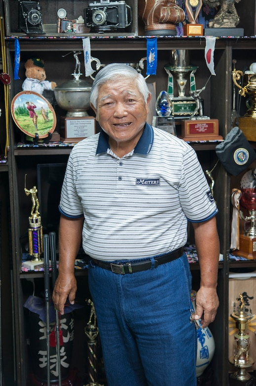 "Tatsuo ""Jimmy"" Schwartz stands in front a shelf of trophies and awards May 4, 2017, in Okinawa, Japan. Schwartz is responsible for many of the events that take place on Kadena Air Base. His contributions directly led to the creation and growth of the Kadena Special Olympics, which is the largest event of its kind in the Air Force."