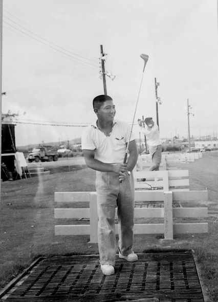 "Tatsuo ""Jimmy"" Schwartz practices his golf at a driving range. Schwartz has maintained the golf courses of Kadena Air Base, Japan, for more than 30 years."
