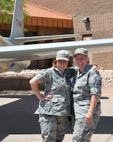 Staff Sgt. Nichole Jordan (left), aerospace medical technician for the 161st Air Refueling Wing Medical Group, and Master Sgt. Peggy Schmidt (right), a supply supervisor for the 161st Air Refueling Wing Logistics Readiness Squadron, pose in front of a 1947 F-84 Thunderjet aircraft static display, 12 May. In honor of mother's day, both airmen express their love and appreciation for each other while serving their state and nation.