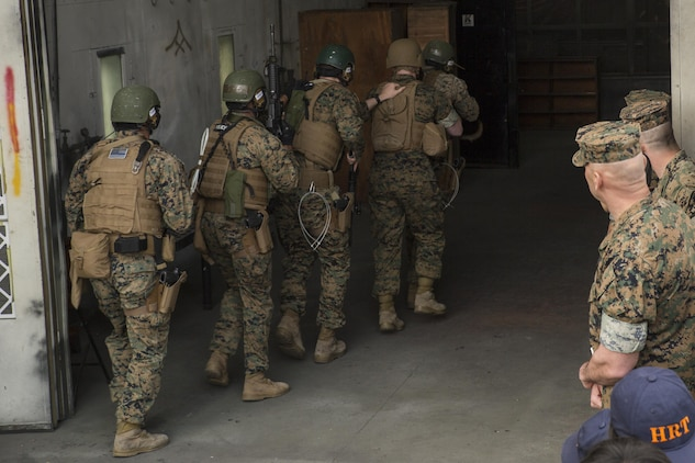 U.S. Marines with the Special Reaction Team (SRT) for Marine Corps Air Station Iwakuni (MCAS), display room-clearing techniques to members of the Hiroshima and Yamaguchi Prefectural Police Headquarters at MCAS Iwakuni, Japan, March 28, 2017. Members with the Hiroshima and Yamaguchi Prefectural Police Headquarters traveled to the air station to observe SRT conduct high-risk training scenarios. The training ranged from room-clearing, breaching, communication and non-lethal take-down techniques. (U.S. Marine Corps photo by Lance Cpl. Joseph Abrego)