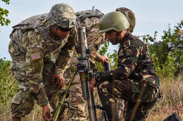 Philippine and U.S. Soldiers change the elevation of a mortar system during Balikatan 2017 at Fort Magsaysay in Santa Rosa, Nueva Ecija, May 14, 2017. By training together the Philippine and U.S. military build upon shared tactics, techniques, and procedures that enhance readiness and response capabilities to emerging threats. Balikatan is an annual U.S.-Philippine bilateral military exercise focused on a variety of missions, including humanitarian assistance and disaster relief, counterterrorism, and other combined military operations.