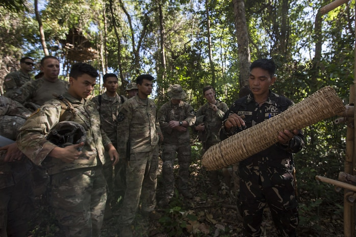 A Philippine Special Forces Soldier shows U.S. Soldiers, 1st Battalion, 23rd Infantry Regiment, a basket made from plant fibers during a subject matter expert exchange in support of Balikatan 2017 at Fort Magsaysay in Santa Rosa, Nueva Ecija, May 13, 2017. U.S. Soldiers trained with Philippine Special Forces to understand the Armed Forces of the Philippines' techniques for operating in a jungle environment. Balikatan is an annual U.S.-Philippine bilateral military exercise focused on a variety of missions, including humanitarian and disaster relief, counterterrorism, and other combined military operations.