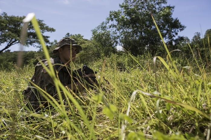 A U.S. Soldier, 1st Battalion, 23rd Infantry Regiment, crouches behind brush during counterterrorism training in support of Balikatan 2017 at Fort Magsaysay in Santa Rosa, Nueva Ecija, May 12, 2017. By training together, the Philippine and U.S. military build upon shared tactics, techniques, and procedures that enhance readiness and response capabilities to emerging threats. Balikatan is an annual U.S.-Philippine bilateral military exercise focused on a variety of missions including humanitarian and disaster relief, counterterrorism, and other combined military operations.