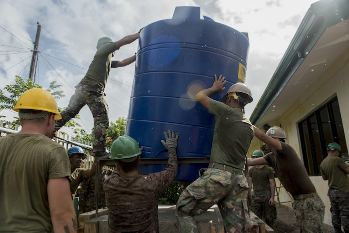 Philippine and U.S. service members install a water storage tank during an engineering civic assistance project in support of Balikatan 2017 in Ormoc City, Leyte, May 12, 2017. Philippine and U.S. service members worked together to build new classrooms for students at Don Carlos Elementary School. Balikatan is an annual U.S.-Philippine bilateral military exercise focused on a variety of missions, including humanitarian assistance and disaster relief, counterterrorism, and other combined military operations.