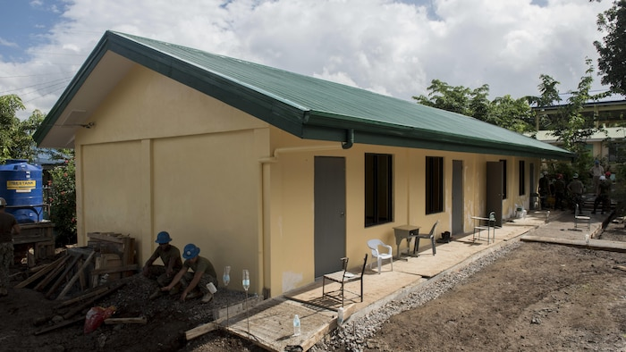 Philippine Soldiers take a short break next to nearly-completed classrooms during an engineering civic assistance project in support of Balikatan 2017 in Ormoc City, Leyte, May 12, 2017. Philippine and U.S. service members worked together to build new classrooms for students at Don Carlos Elementary School. Balikatan is an annual U.S.-Philippine bilateral military exercise focused on a variety of missions, including humanitarian assistance and disaster relief, counterterrorism, and other combined military operations.
