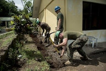 Philippine and U.S. service members dig a drainage ditch during Balikatan in Ormoc City, Leyte, May 12, 2017. Philippine and U.S. service members worked together to build new classrooms for students at Don Carlos Elementary School. Balikatan is an annual U.S.-Philippine bilateral military exercise focused on a variety of missions, including humanitarian assistance and disaster relief, counterterrorism, and other combined military operations.