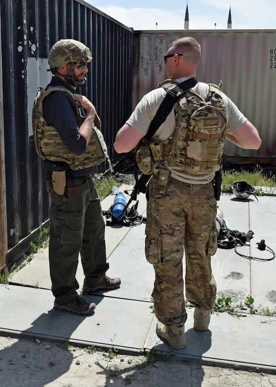 Master Sgt. Matthew Lutz, 438th Air Expeditionary Wing and Train, Advise, Assist Command – Air (TAAC-Air) CJ-ENG superintendent, chats with Joshua Mayes, 438th AEW and TAAC-Air historian before a controlled burn house exercise May 11, 2017 on Kabul Air Wing. Historians frequently visit units to document training missions and other significant events. (U.S. Air Force photo by Maj. William Russell)
