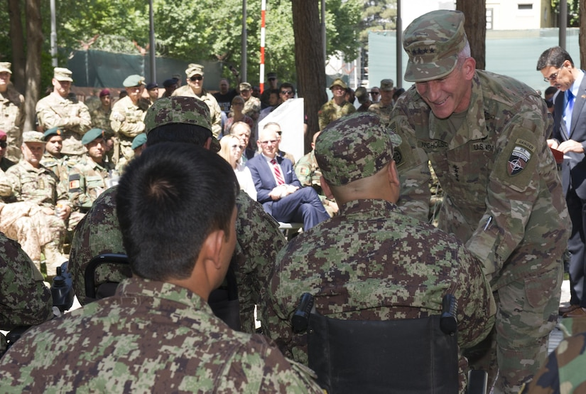 """KABUL, Afghanistan (April 12, 2017) — General John Nicholson, Resolute Support commander, greets wounded Afghan warriors who participated in the final team selection trials for the Invictus Games Toronto 2017.   """"You have been tested and you prevailed, right alongside your comrades, your brothers. In particular, the Afghan Army has excelled over the last few years, fighting in a war that would break most armies; yet, it continues to spring up with a warrior spirit; fighting for what is right and just,"""" Nicholson said.  (U.S. Navy photo by Lt. j.g. Egdanis Torres Sierra, Resolute Support Public Affairs – Afghanistan)"""