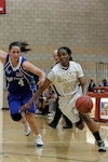 Army Capt. Octavia Blackwell dribbles past a defender during an Army-Air Force game, April 28, 2017. Army photo by Maj. Bryen C. Freigo