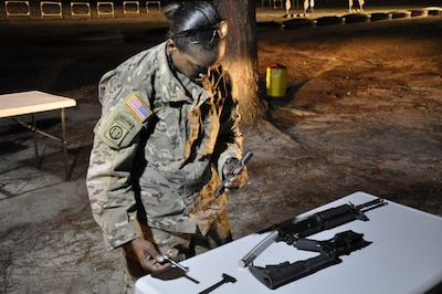 Army Capt. Octavia Blackwell conducts weapons assembly during the Best Civil Affairs Team competition at Fort Bragg, N.C., March 6, 2017. Army photo by Maj. Bryen C. Freigo