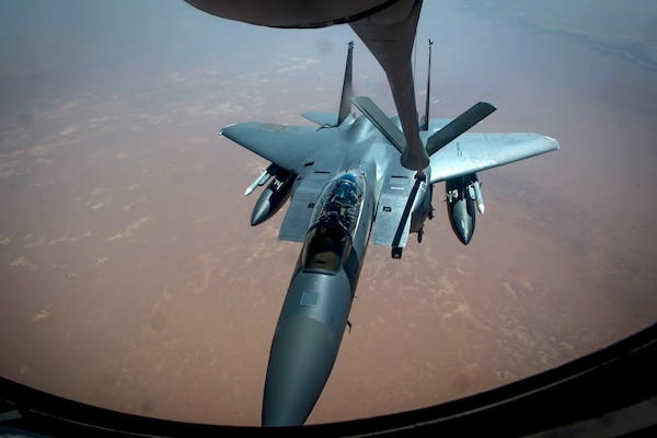 An Air Force F-15 Strike Eagle aircraft receives fuel from a KC-135 Stratotanker during a mission in support of Operation Inherent Resolve, May 9, 2017. Air Force photo by Staff Sgt. Michael Battles