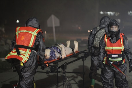 U.S. Army Reserve Soldiers from Madison, Wisconsin, based 409th Area Support Medical Company and 414th Chemical Company based in Orangeburg, South Carolina, work together to complete a mass casualty decontamination exercise May 8, 2017 at Muscatatuck Urban Training Center, Indiana. Nearly 4,100 Soldiers from across the country are participating in Guardian Response 17, a multi-component training exercise to validate U.S. Army units' ability to support the Defense Support of Civil Authorities (DSCA) in the event of a Chemical, Biological, Radiological, and Nuclear (CBRN) catastrophe. (U.S. Army Reserve photo by Sgt. Crystal Milton)