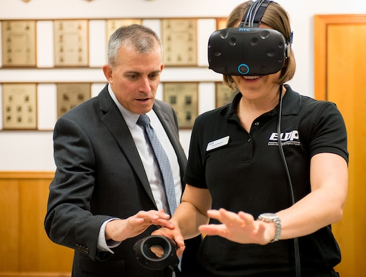 Department of Defense's 2017 Executive Leadership Development Program participant Amanda McGlone (right) experiences virtual reality simulations during the group's visit to 25th Air Force Headquarters at Joint Base San Antonio-Lackland, Texas May 9.