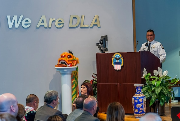 """Columbus Police Officer Edward Chung speaks to the Defense Federal Community inside the DLA Land and Maritime Operations Center during Defense Supply Center Columbus' annual Asian American Pacific Islander (AAPI) Month celebration May 10. Chung's presentation followed the event's theme of """"Unite Our Voices by Speaking Together."""""""