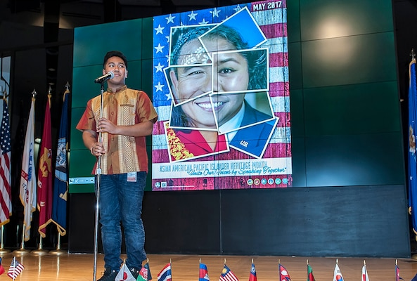 """Tanaka Nhong, a founding member of the Khmer Student Association at The Ohio State University, sings the famous Cambodian song, """"Louch Snae Doung Chan (The Moon that Stole My Heart)."""" Nhong's performance took place during the Asian American and Pacific Islander heritage month program at Defense Supply Center Columbus on May 10."""