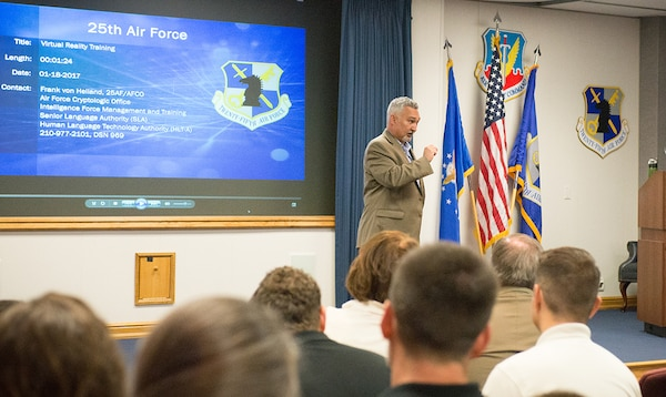 """Frank """"Chip"""" von Heiland, Air Force Cryptologic Office, 25th Air Force, discusses virtual reality training options with the Department of Defense's 2017 Executive Leadership Development Program participants at 25th Air Force Headquarters at Joint Base San Antonio-Lackland, Texas May 9."""