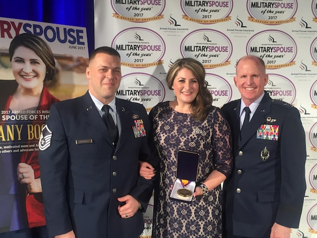 Mrs. Brittany Boccher is flanked by husband Master Sgt. (Special Agent) Adam Boccher of Air Force Office of Special investigations Detachment 327, Little Rock Air Force Base, Ark., and Gen. Stephen W. Wilson, Air Force Vice Chief of Staff, after she received the 2017 Armed Forces Insurance Military Spouse of the Year Award May 12, at the U.S, Chamber of Commerce in Washington, D.C. (Photo by Suzanne Trevino/Gordon C. James Public Relations)