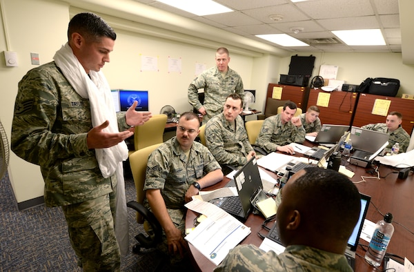 Staff Sgt. Brandon Taylor, 55th Contracting Squadron contract officer, provides guidance during a simulated payment discrepancy as part of a scenario used in a contracting contingency exercise May 10, 2017 at Offutt Air Force Base, Neb. The exercise lasted five days from May 8 – 12 and was designed to improve contracting readiness for bare base operations. (U.S. Air Force photo by Delanie Stafford)