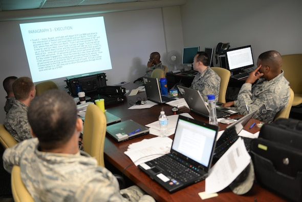 MSgt. James Arent, 55th Security Forces Squadron NCOIC of training, conducts convoy contingency training for Airmen assigned to the 55th Contracting Squadron at Offutt Air Force Base, Neb., May 10, 2017. Airmen participated in classroom instruction, with an in-depth discussion about what to expect in a deployed environment and how to properly handle different scenarios. (U.S. Air Force photo by Zachary Hada)