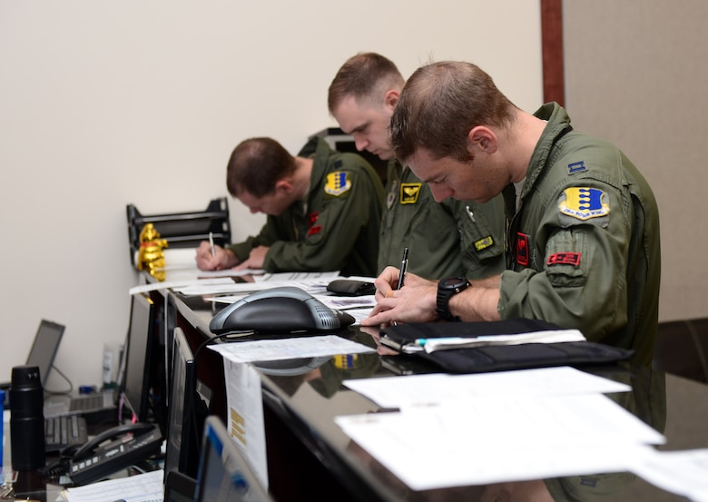 Pilots and weapon systems officers assigned to the 34th and 37th Bomb Squadrons, attend a step brief during the Combat Hammer exercise at Ellsworth Air Force Base, S.D., May 10, 2017. Combat Hammer is designed to assess and evaluate the reliability, maintainability, suitability and accuracy of precision-guided air-to-ground munitions. (U.S. Air Force photo by Airman 1st Class Donald C. Knechtel)