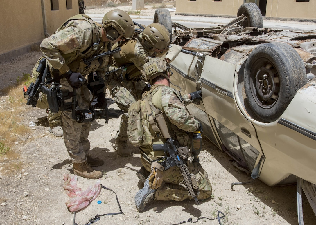 AMMAN, Jordan (May 11, 2017) Members of the Air Force and Italian Special Operations attempt to gain access to a vehicle during a combat search and rescue exercise in support of Eager Lion 2017. Eager Lion is an annual U.S. Central Command exercise in Jordan designed to strengthen military-to-military relationships between the U.S., Jordan and other international partners. This year's iteration is comprised of about 7,200 military personnel from more than 20 nations that will respond to scenarios involving border security, command and control, cyber defense and battlespace management. (U.S. Navy photo by Mass Communication Specialist 2nd Class Christopher Lange/Released)