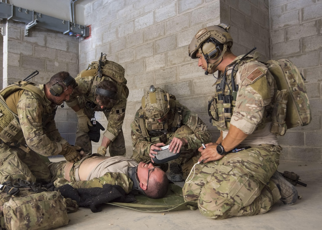 AMMAN, Jordan (May 11, 2017) Members of the Air Force and Italian Special Operations provide medical care during a combat search and rescue exercise in support of Eager Lion 2017. Eager Lion is an annual U.S. Central Command exercise in Jordan designed to strengthen military-to-military relationships between the U.S., Jordan and other international partners. This year's iteration is comprised of about 7,200 military personnel from more than 20 nations that will respond to scenarios involving border security, command and control, cyber defense and battlespace management. (U.S. Navy photo by Mass Communication Specialist 2nd Class Christopher Lange/Released)