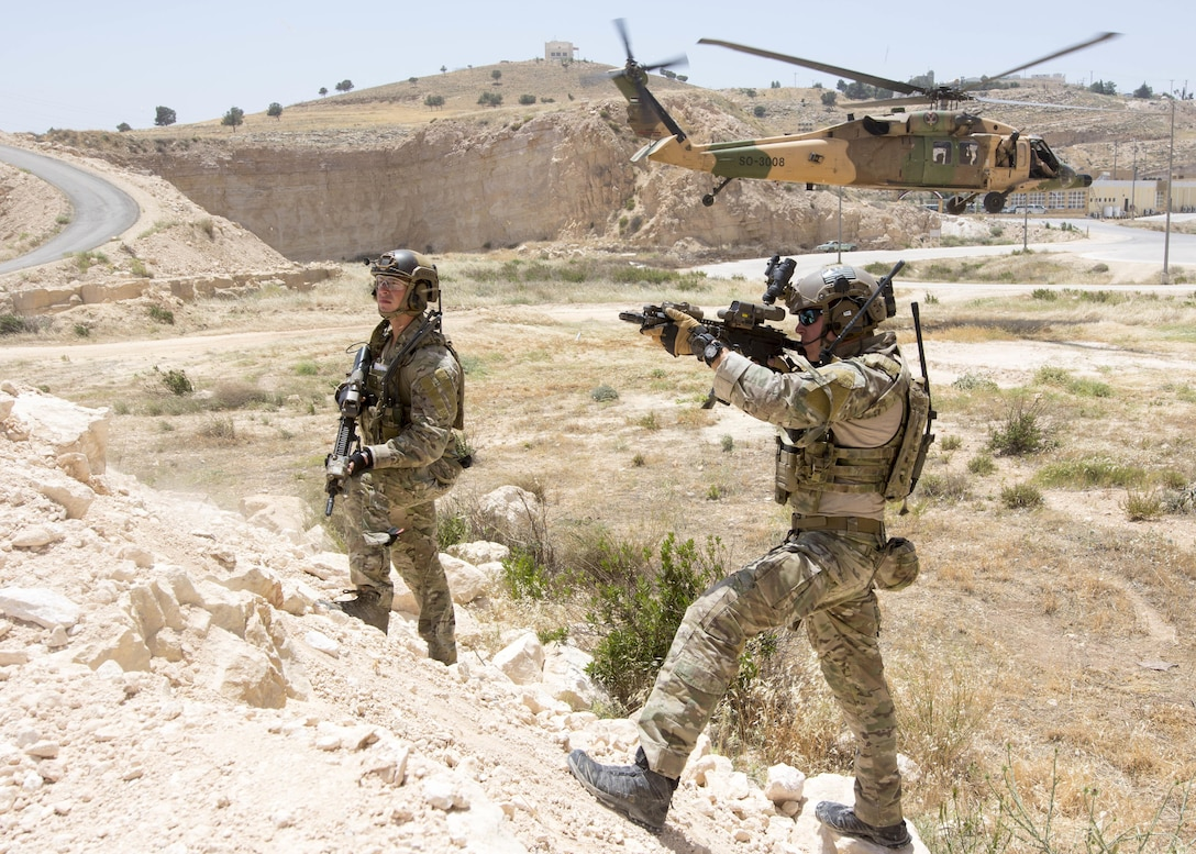 AMMAN, Jordan (May 11, 2017) Members of the Air Force Special Operations, assigned to the 23rd Special Tactics Squadron, provide security of a landing zone during a combat search and rescue exercise in support of Eager Lion 2017. Eager Lion is an annual U.S. Central Command exercise in Jordan designed to strengthen military-to-military relationships between the U.S., Jordan and other international partners. This year's iteration is comprised of about 7,200 military personnel from more than 20 nations that will respond to scenarios involving border security, command and control, cyber defense and battlespace management. (U.S. Navy photo by Mass Communication Specialist 2nd Class Christopher Lange/Released)