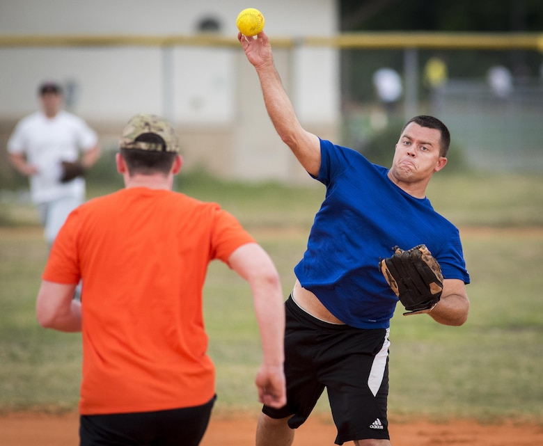33rd Maintenance Group team second baseman, Jeffrey Beazey, tries for a double-play during their team's intramural softball game against the 96th Communications Squadron team at Eglin Air Force Base, Fla., May 11.  The CS team won easily over the MXG team during the opening week of the intramural softball season.  (U.S. Air Force photo/Samuel King Jr.)