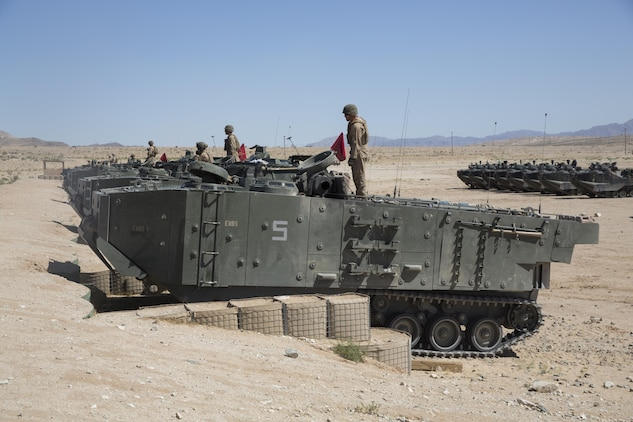 Marines with 3rd Assault Amphibious Battalion prepare for a live fire exercise at Range 106 A aboard Marine Corps Air Ground Combat Center, Twentynine Palms, Calif., May 4, 2017. Marine Corps Operational Test and Evaluation Activity Office conducted the exercise as part of operational testing used to compare an upgraded AAV to its old variant. (U.S. Marine Corps photo by Cpl. Thomas Mudd)