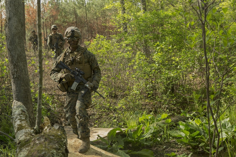 A Marine patrols a path during a company attack exercise at Fort A.P. Hill, Va., May 1, 2017. The Marines conducted a live-fire exercise that helped improve their leadership and teamwork abilities. The Marines are with G Company, 2nd Battalion, 2nd Marine Regiment. (U.S. Marine Corps photo by Pfc. Abrey D. Liggins)