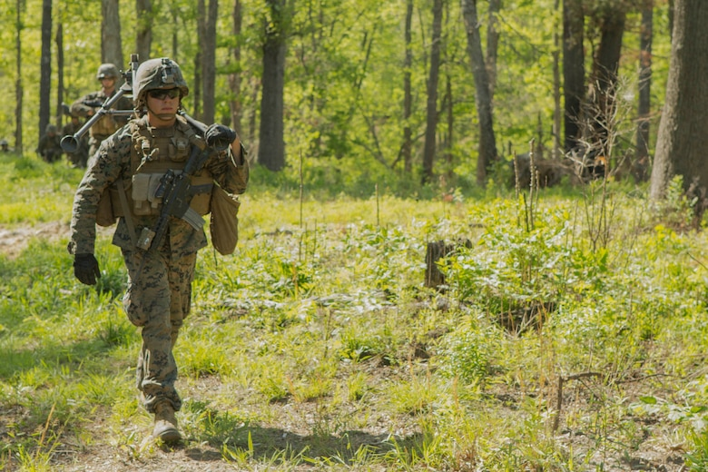 A Marine carries a machine gun tripod on a patrol during a company attack exercise at Fort A.P. Hill, Va., May 1, 2017. The Marines conducted a live-fire exercise that helped improve their leadership and teamwork abilities. The Marines are with G Company, 2nd Battalion, 2nd Marine Regiment. (U.S. Marine Corps photo by Pfc. Abrey D. Liggins)