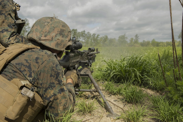 A Marine fires an M240B machine gun at a target during a company attack exercise at Fort A.P. Hill, Va., May 1, 2017. The Marines conducted a live-fire exercise that helped improve their leadership and teamwork abilities. The Marines are with G Company, 2nd Battalion, 2nd Marine Regiment. (U.S. Marine Corps photo by Pfc. Abrey D. Liggins)