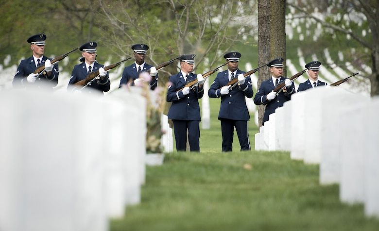 U.S. Air Force Honor Guard firing party shoots their M-14 rifles during a funeral service at Arlington National Cemetery in Arlington, Va., April 13, 2017. The firing party perform a firing of three volleys to give honors to those who have fallen. (U.S. Air Force photo by Senior Airman Philip Bryant)