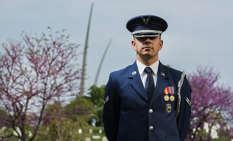 Airman 1st Class Jose Velazquez, U.S. Air Force Honor Guard firing party member, stands in an Air Force ceremonial uniform at Arlington National Cemetery in Arlington, Va., April 15, 2017. Velazquez came to America from Mexico at a young age and dreamed of joining the military. (U.S. Air Force photo by Senior Airman Philip Bryant)