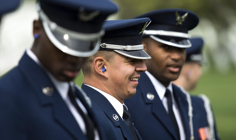 Airman 1st Class Jose Velazquez, U.S. Air Force Honor Guard firing party member, smiles with other firing party members at Arlington National Cemetery in Arlington, Va., April 13, 2017. Velazquez gained citizenship after completing Air Force basic training and is now in a coveted position amongst the U.S. Air Force Honor Guard firing party. (U.S. Air Force photo by Senior Airman Philip Bryant)