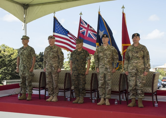 Navy Adm. Harry B. Harris, commander of U.S. Pacific Command, left, Army Gen. Raymond A. Thomas, commander, U.S. Special Operations Command, Marine Corps Maj. Gen. Daniel D. Yoo, commander, U.S. Special Operations Command, Pacific (SOCPAC), Army Maj. Gen. Bryan P. Fenton, and Command Sgt. Maj. Shane Shorter stand during the playing of the Armed Services Medley at the conclusion of SOCPAC's Change of Command ceremony, May 12, 2017