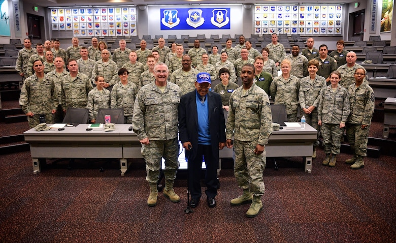 Tuskegee Airman, retired Lt. Col. Robert (Bob) J. Friend, poses with attendees to the 932nd Airlift Wing professional development seminar May 8, 2017 at the Global Reach Planning Center, Scott Air Force Base, Illinois. Friend is one of the few surviving Red Tail pilots from WWII.  He shared his experience with becoming a pilot and overcoming racial barriers as he transitioned from the Army Air Corps to the Air Force. (U.S. Air Force photo by Christopher Parr)