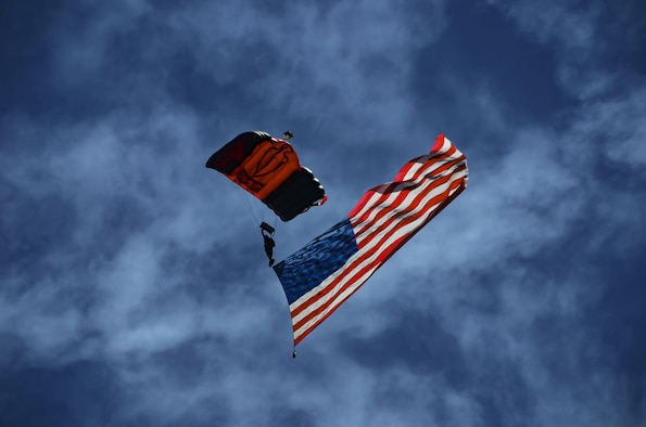The U.S. Army Special Operations Command Black Daggers Parachute Team jumps with the American Flag during the South Carolina National Guard Air and Ground Expo at McEntire Joint National Guard Base, South Carolina, May 7, 2017. This expo is a combined arms demonstration showcasing the abilities of South Carolina National Guard Airmen and Soldiers while saying thank you for the support of fellow South Carolinians and the surrounding community. (U.S. Air National Guard photo by Tech. Sgt. Nicole Szews)